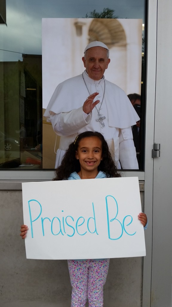 Young girl at encyclical celebration