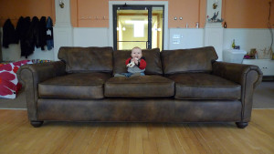 Kid sitting on a couch