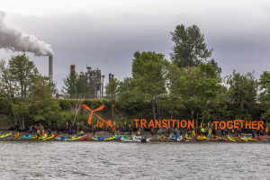 Just Transition kayaks outside shell refinery in Anacortes